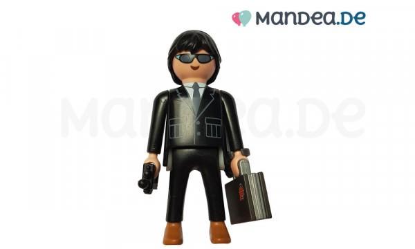 PLAYMOBIL® Agent mit Koffer und Funkgerät